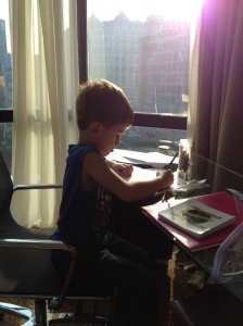 James loves to draw, color and design. Here, he is working on some homework with a great view of Beijing!