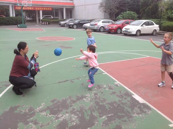 The Assistant Orphanage Director took many photos of Mei Li playing ball with the boys.