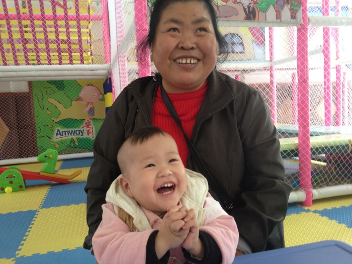 Mei Li and her foster mom in the orphanage playroom.
