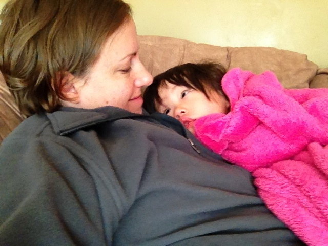 Month 6 - April 20, 2015 : Mei has a high fever all week, so we didn't take her traditional picture in her silk. Instead, we snuggle on the couch for long hours.